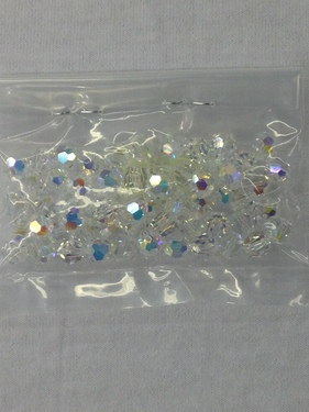 Photo of CRYSTAL 7MM FACETED SWAROVSKI CRYSTAL BEADS WITH AURORA BOREALIS COATING 618C